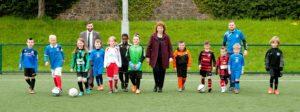 Active kids with coach & teachers